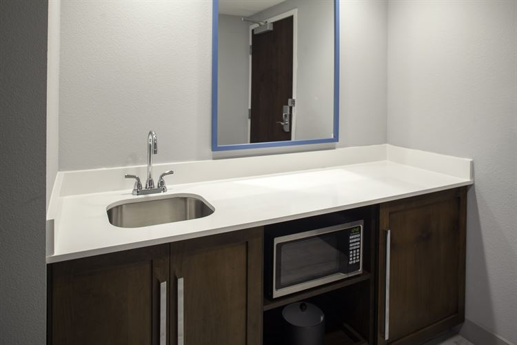 Bathroom countertop with in room safe